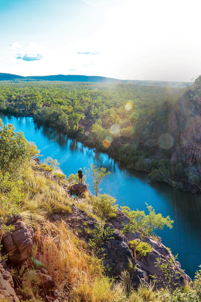 a hiker stands over the main gorge of Nitmiluk National Park