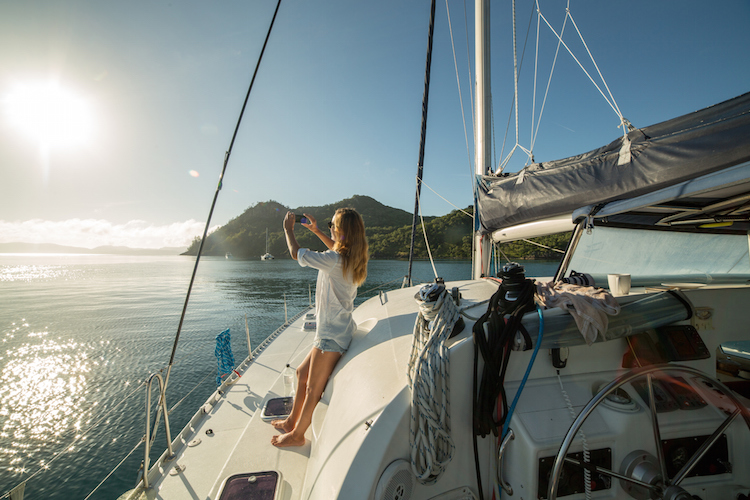 girl on yacht taking a photo