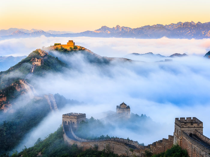 great wall of china at sunrise with fog