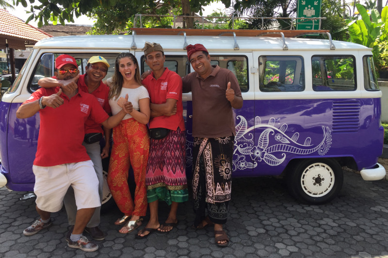 Balinese drivers and tourist in front of Kombi van, Bali, Indonesia