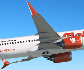 Malindo Air plane in sky.